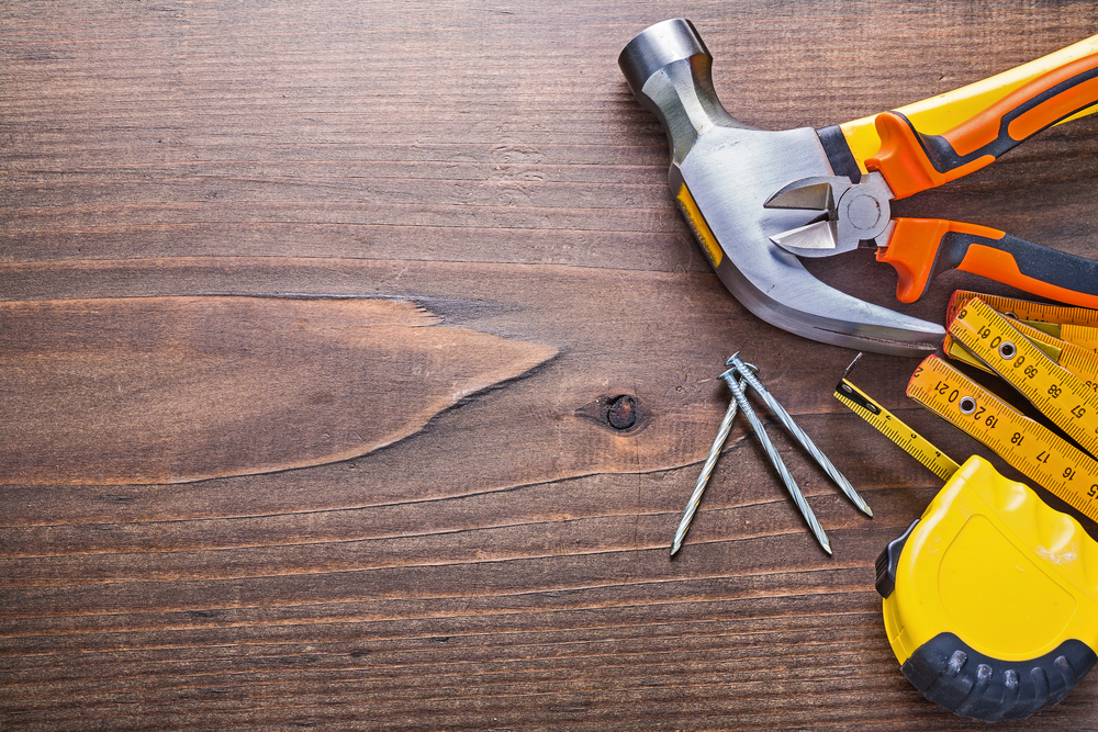 Claw hammer resting alongside other tools