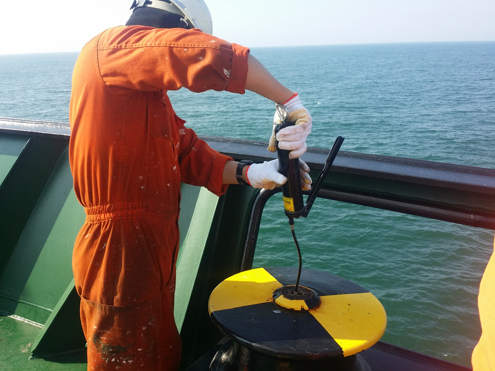 Grease gun being used for marine purposes