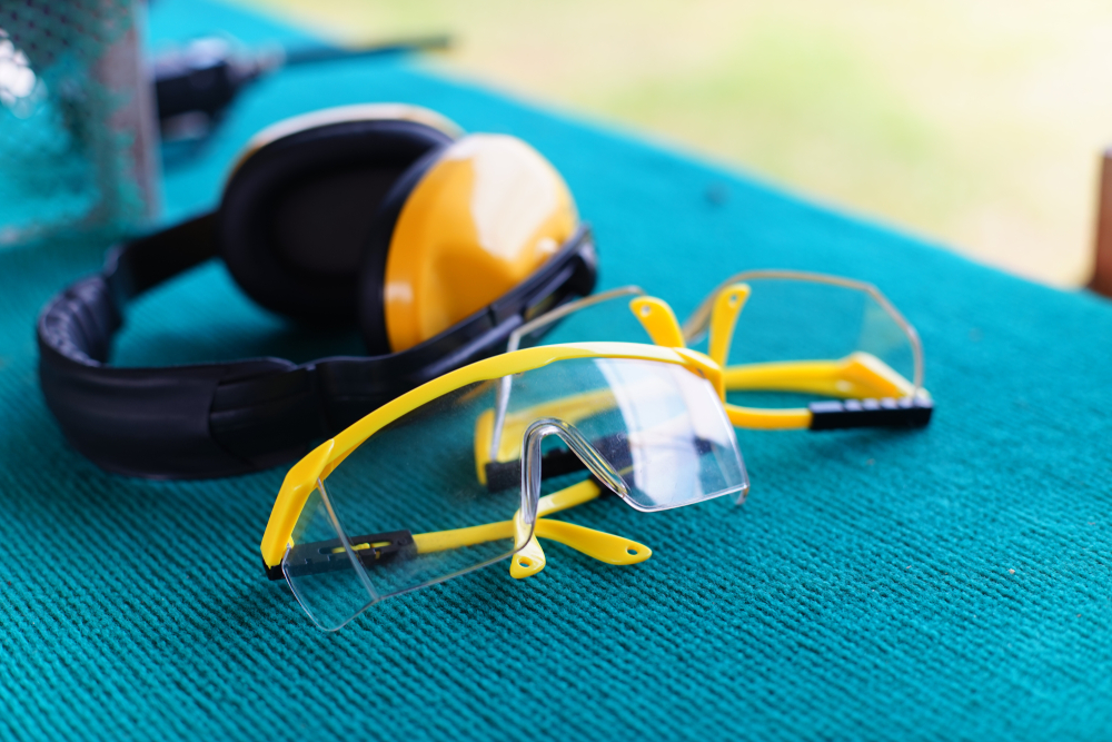 Yellow shooting earmuffs and safety glasses