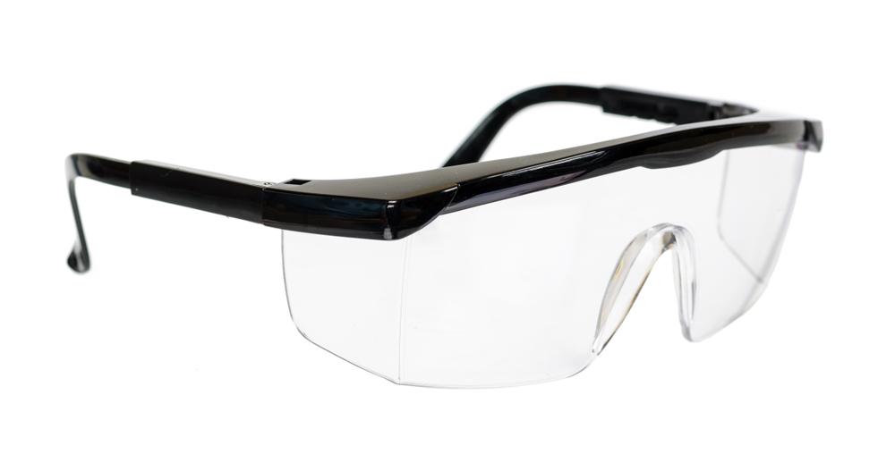 Safety glasses over white background
