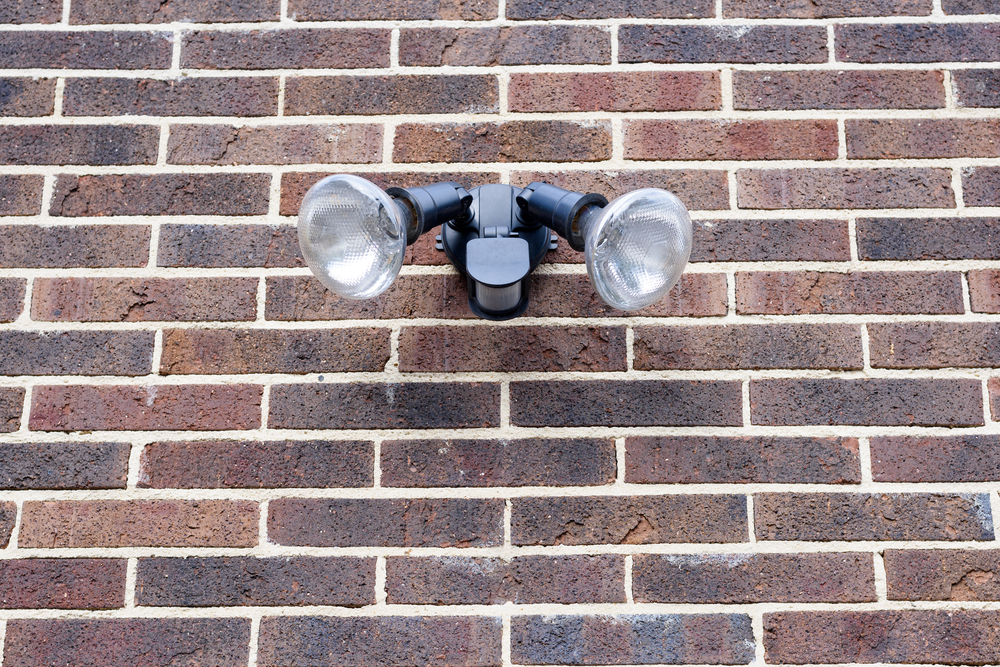 motion detector security light against brick wall