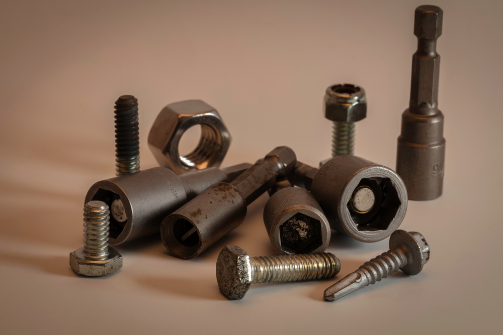 Nut drivers and screw fasteners
