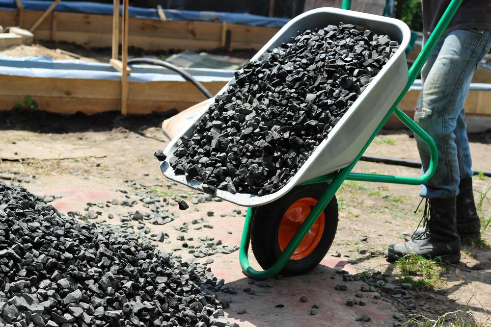 Wheelbarrow dumping rocks