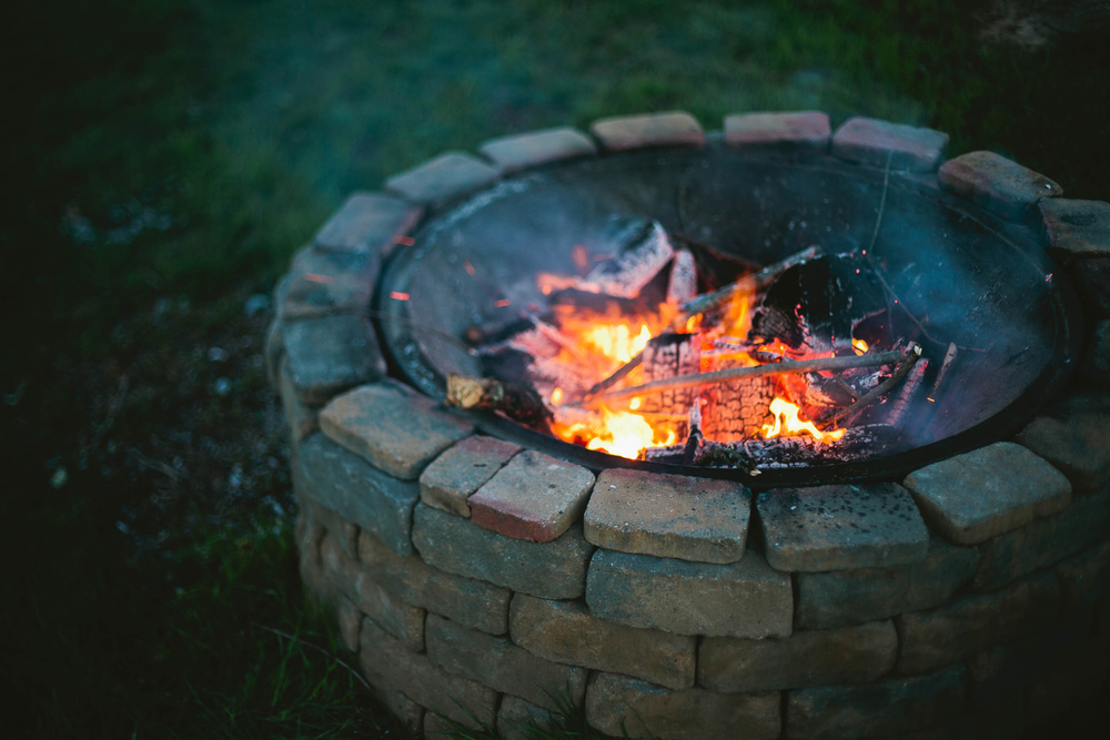 A firepit burning in the evening