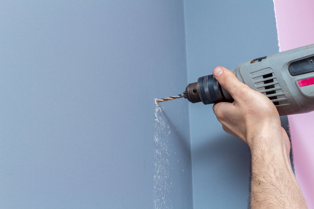drilling into a wall