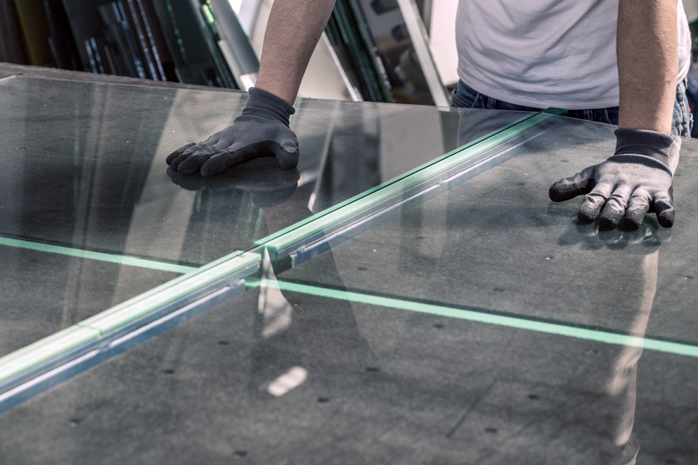 glazier breaking glass on table