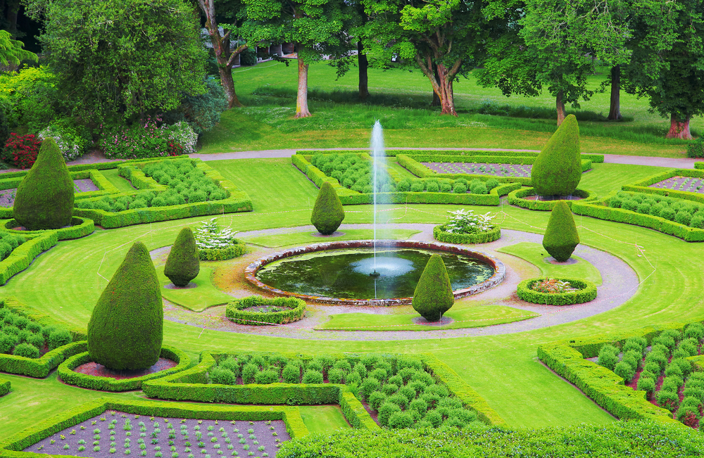 green formal garden with fountain