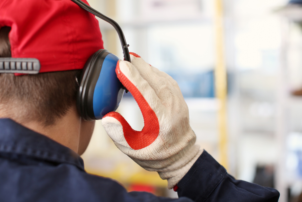 person putting on protective gear on ears