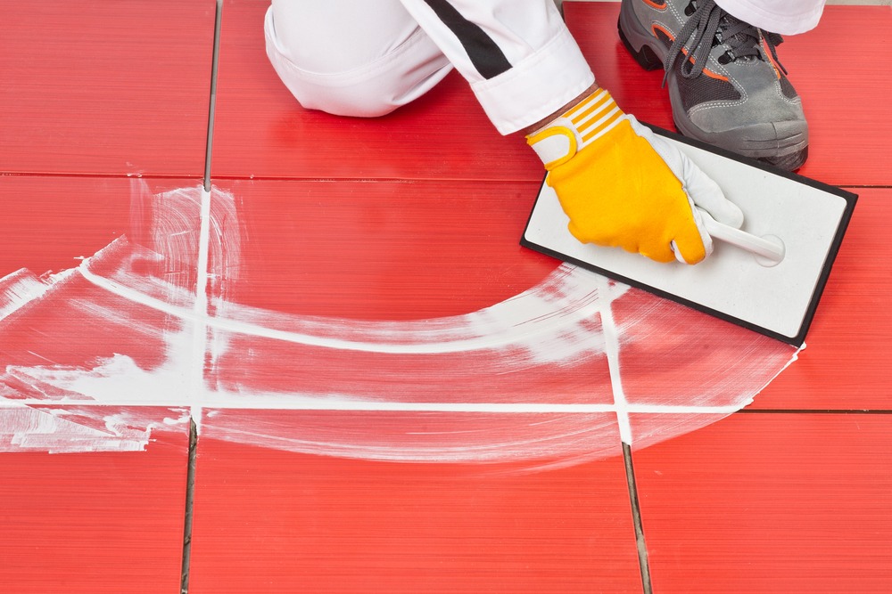 Applying grout to tiles on a 45-degree angle