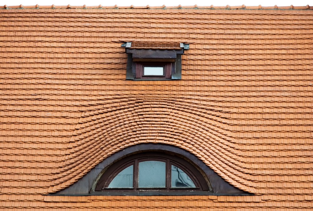 Eyebrow dormer window