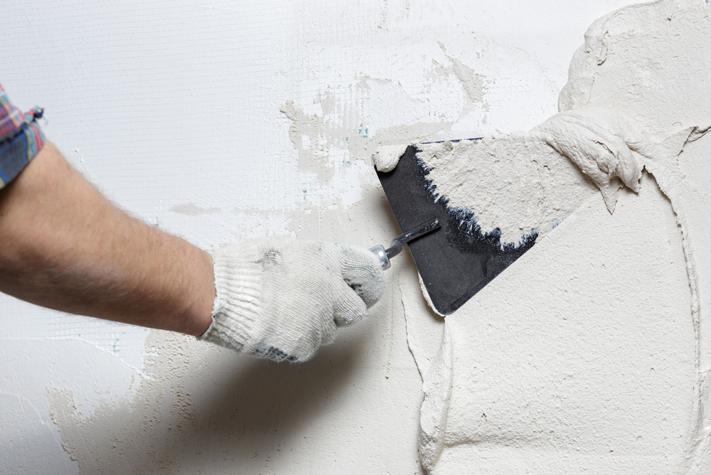 Spreading plaster on wall
