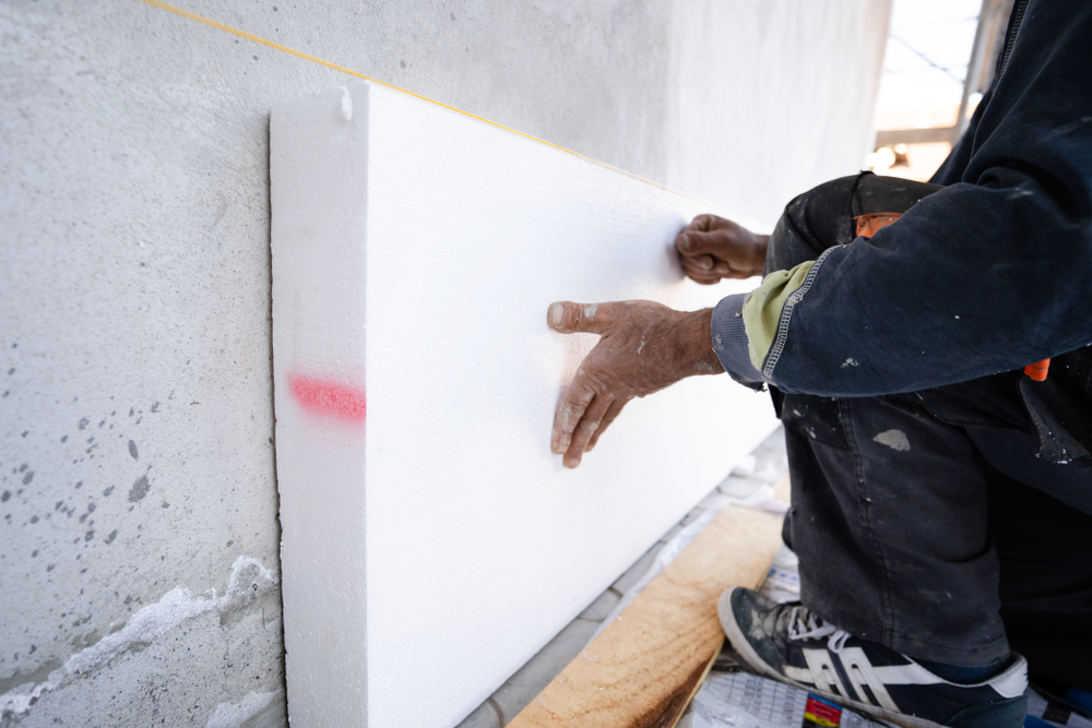 Worker installing foam board