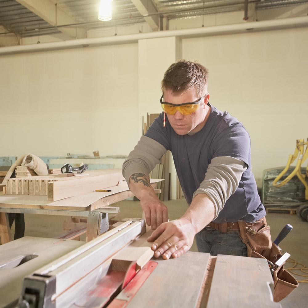 man uses a table saw