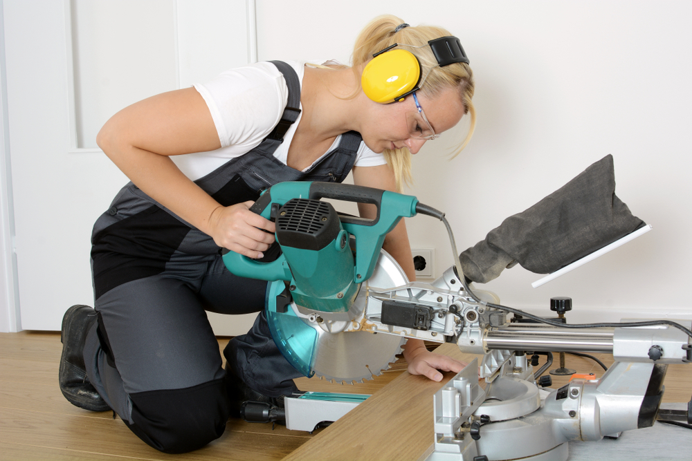 woman uses a miter saw