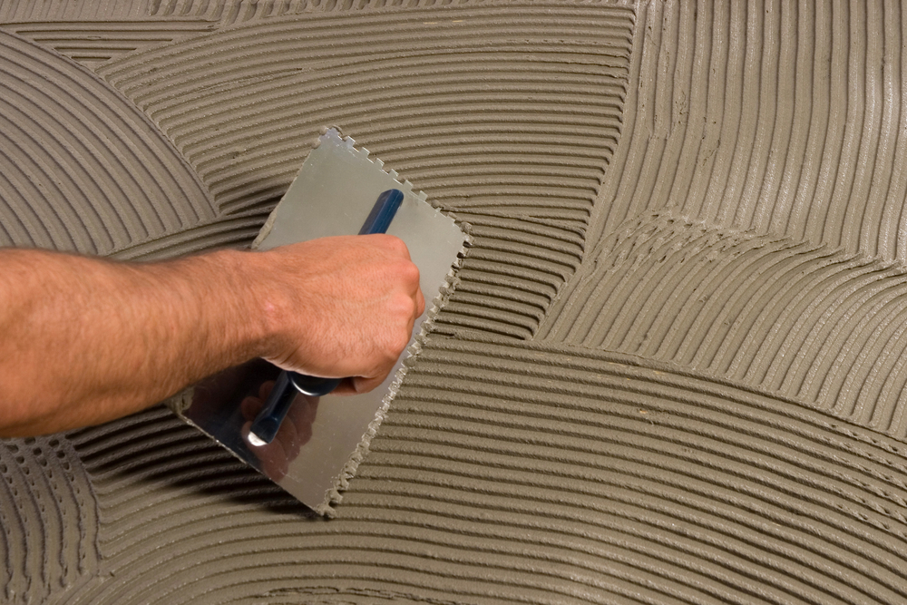 Applying mortar with tile float