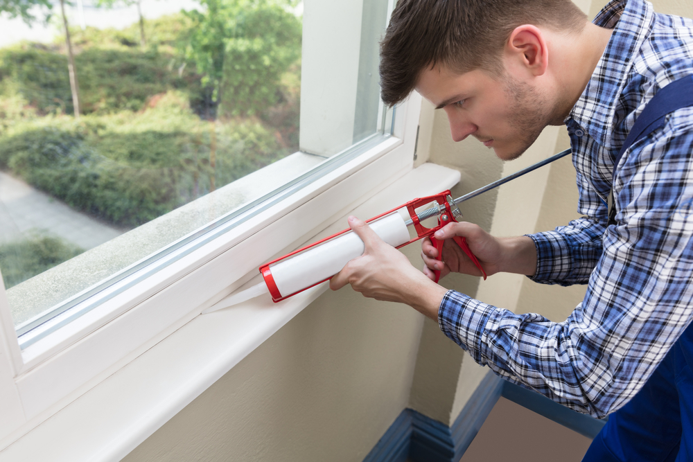 Applying new caulk after removing the old