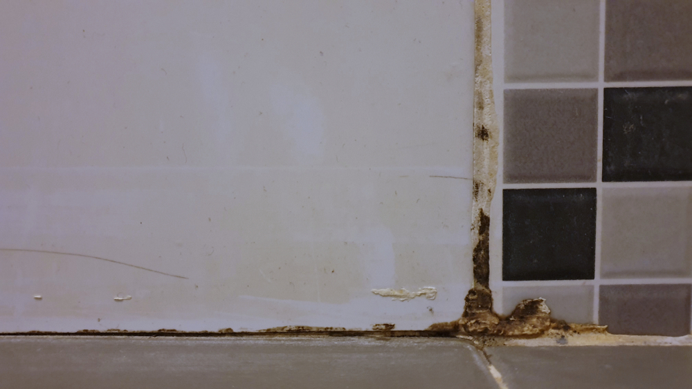 Dirty and damaged caulk that needs to be removed