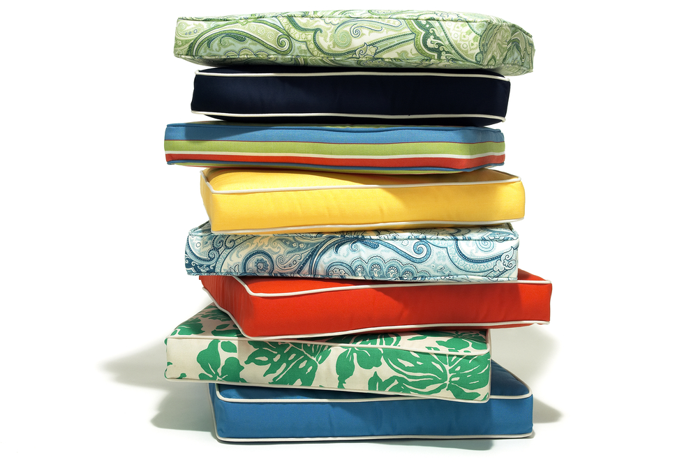 a pile of colorful outdoor cushions