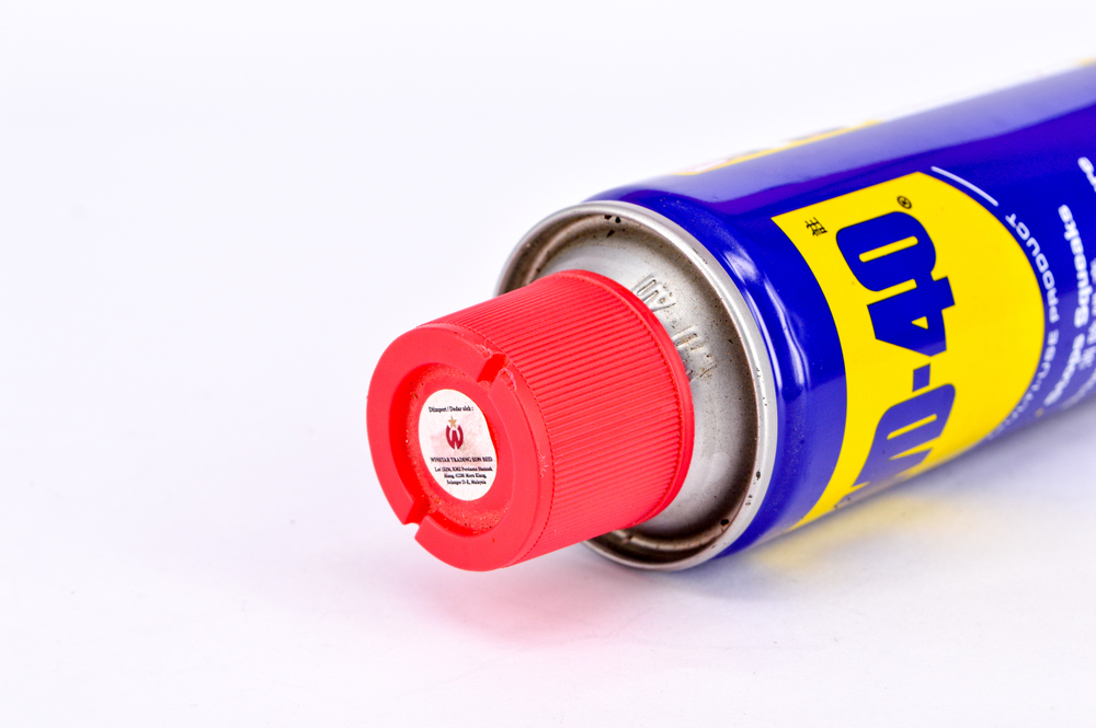 can of WD-40 with white background