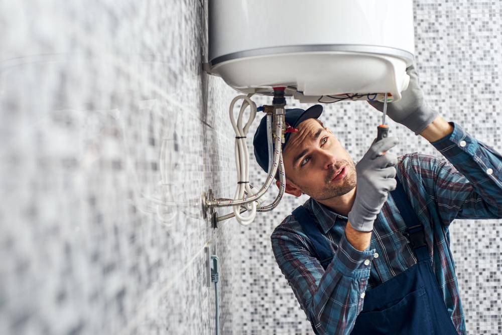 man working on water heater