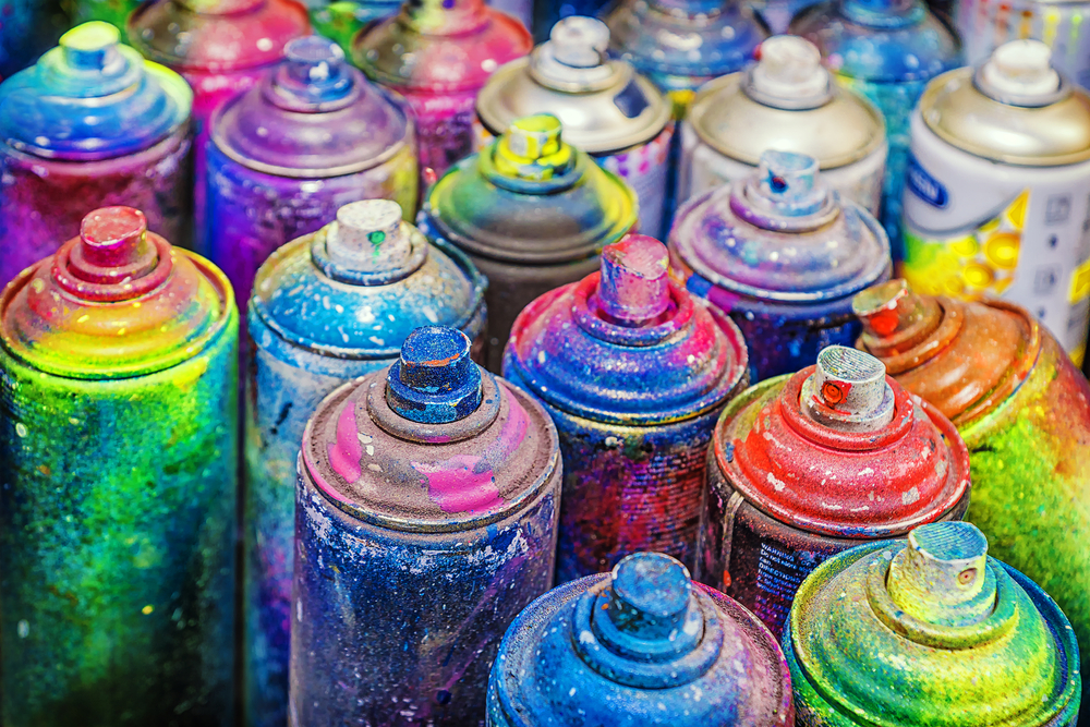 paint-covered cans of used spray paint