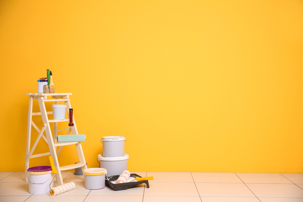 paint tools and yellow wall