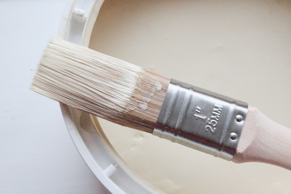 paintbrush on edge of paint can