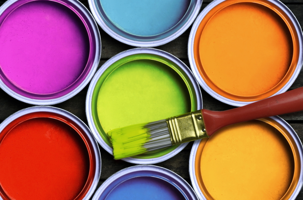 several tins of colorful paint