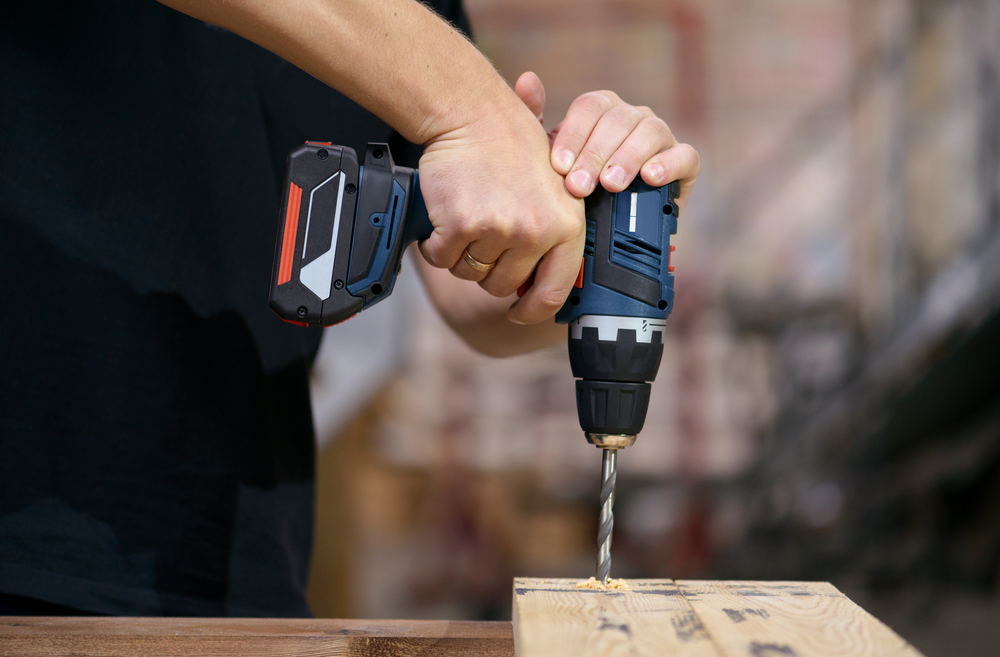 small drill making a hole in wood