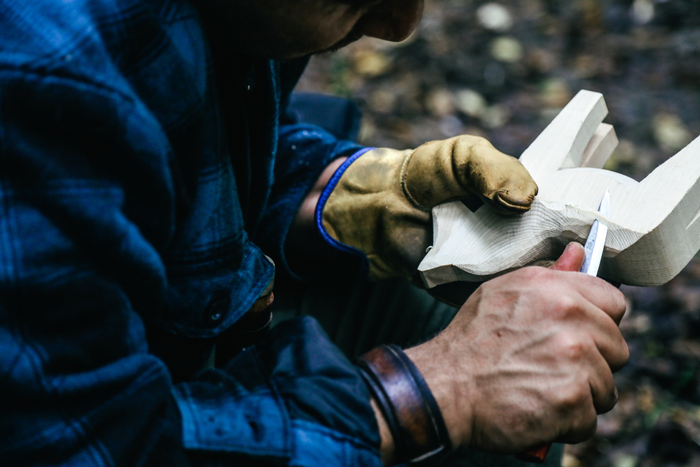 Man whittling a horse