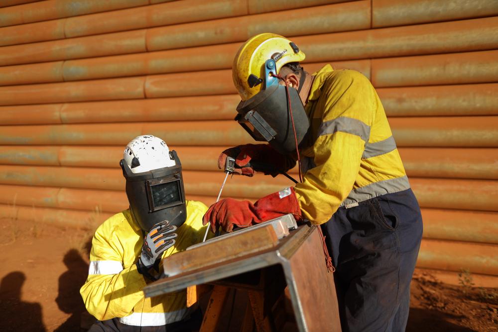 Welders wearing appropriate safety gear