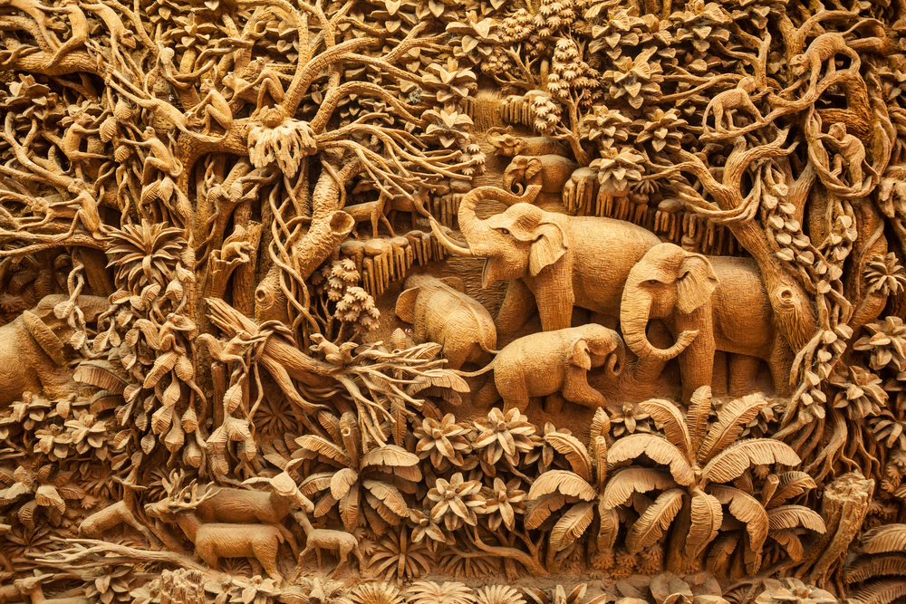 relief carving of elephants in a jungle