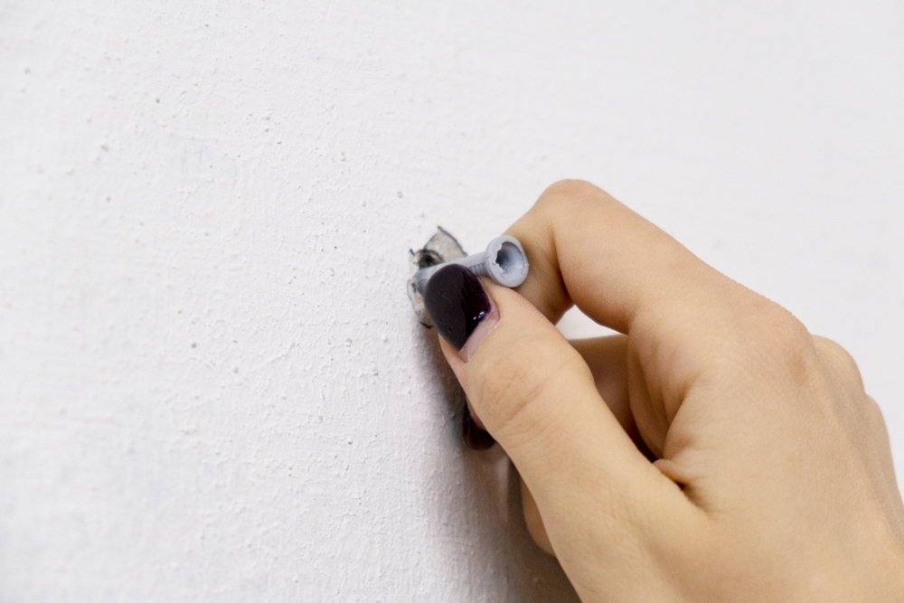 removing plastic wall anchor