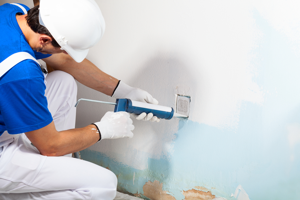 caulk applied to painted wall